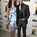 Anne Hathaway congratulated Joseph Gordon-Levitt on his Breakthrough Actor award at the Hollywood Film Awards.