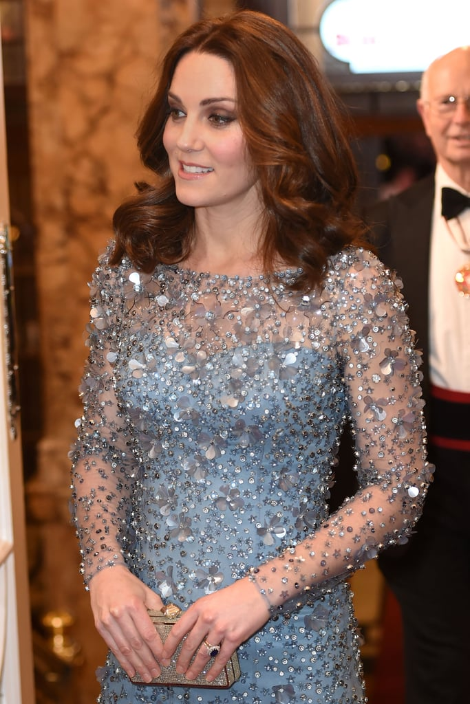 Kate Middleton isn't just any princess; she's a Disney princess. Well, at least just for one night. The Duchess of Cambridge attended the Royal Variety Performance at Palladium Theatre in London on Nov. 24, and for the special occasion she wore an icy-blue, crystal-beaded gown. The color of the dress had an uncanny resemblance to the one Elsa wore in Frozen, and it twinkled like stars from every angle. Though the Jenny Packham number was created with sheer material, a matching blue slip underneath made the look more royal approved.  Kate's worn Jenny Packham to a number of events, but this dress might be our favorite so far. Blue is truly her power color. The royal wore a pair of shimmery Oscar de la Renta pumps to complete her ensemble and seemed at ease in heels despite being pregnant. Read on to see Kate's glamorous night out, then shop similar dresses.      Related:                                                                                                           Kate Middleton Went For the Anti-Princess Dress at the BAFTAs