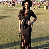 Source: Getty Fringing is the answer to adding movement and flair to your look. Combine a leather or suede fringe skirt with a fedora and metallic accessories (stacked rings are great!) to add a trendy twist to your look.