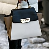 Jessica Hart toted a colorblock Zac Posen bag.