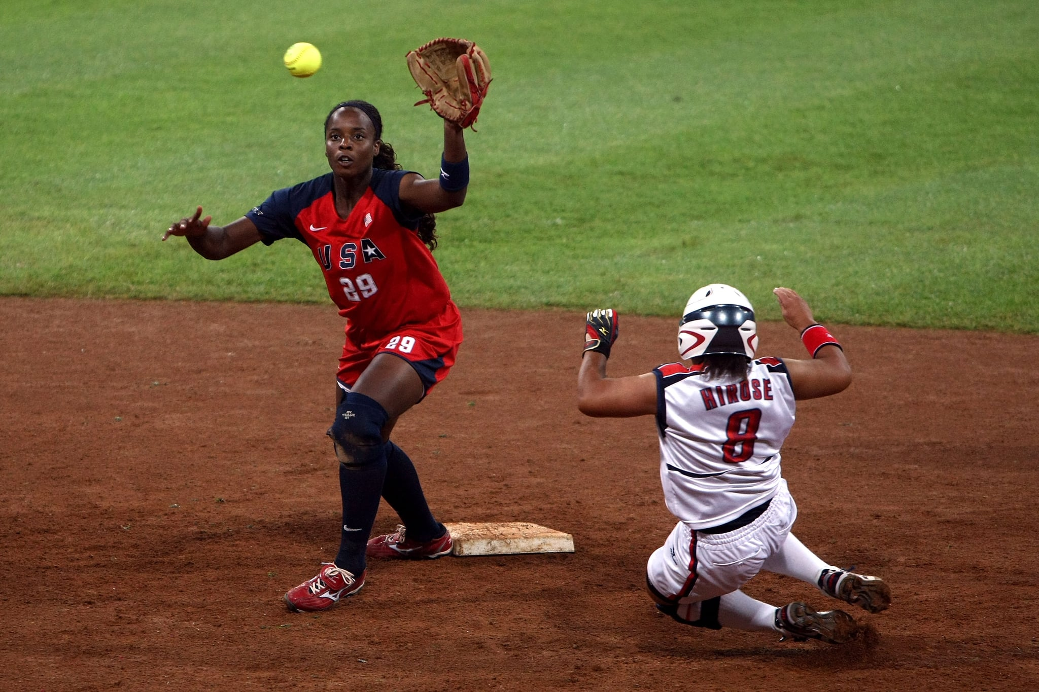 BEIJING - AUGUST 21:  Megu Hirose #8 of Japan slides into second base as shortstop Natasha Watley #28 of the United States waits for the ball during the women's grand final gold medal softball game at the Fengtai Softball Field during Day 13 of the Beijing 2008 Olympic Games on August 21, 2008 in Beijing, China.  (Photo by Jonathan Ferrey/Getty Images)