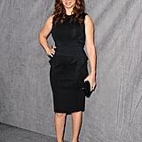 Maya Rudolph in a black sheath dress.