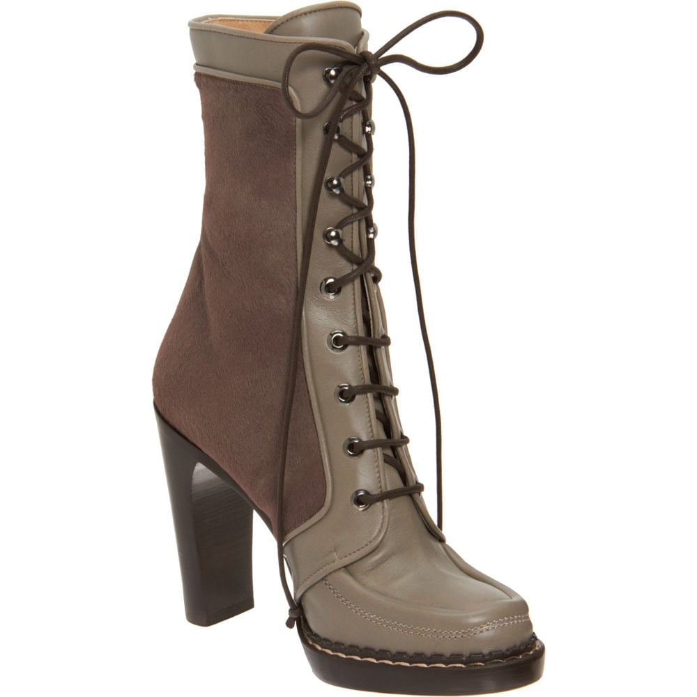 The Proenza Schouler lace-up boot is sleek and seasonless. Whether you get them now and save 'em for next Fall or wear them year-round, it's a classic shape and color palette. Proenza Schouler Lace-Up Mid Boot ($579, originally $1,450)