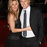 She held on to Owen Wilson as they attended the LA premiere of Marley & Me in December 2008.
