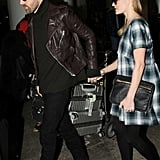 Michael Polish held on to Kate Bosworth as the couple walked through LAX.