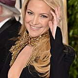 America sweetheart Kate Hudson stole the carpet with her fashion-forward, low-cut Alexander McQueen gown.