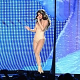 "Removing the black dress, the ""Hands to Myself"" singer showed off a neutral shimmery bodysuit she was wearing underneath."