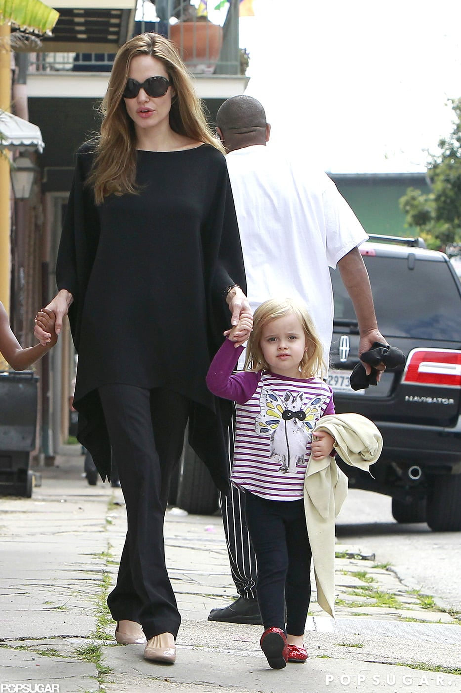 Angelina Jolie took Vivienne Jolie-Pitt by the hand during a visit to the market in New Orleans in March 2012.