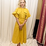 For a press conference in Canada, the actress wore this delightful mustard midi dress.