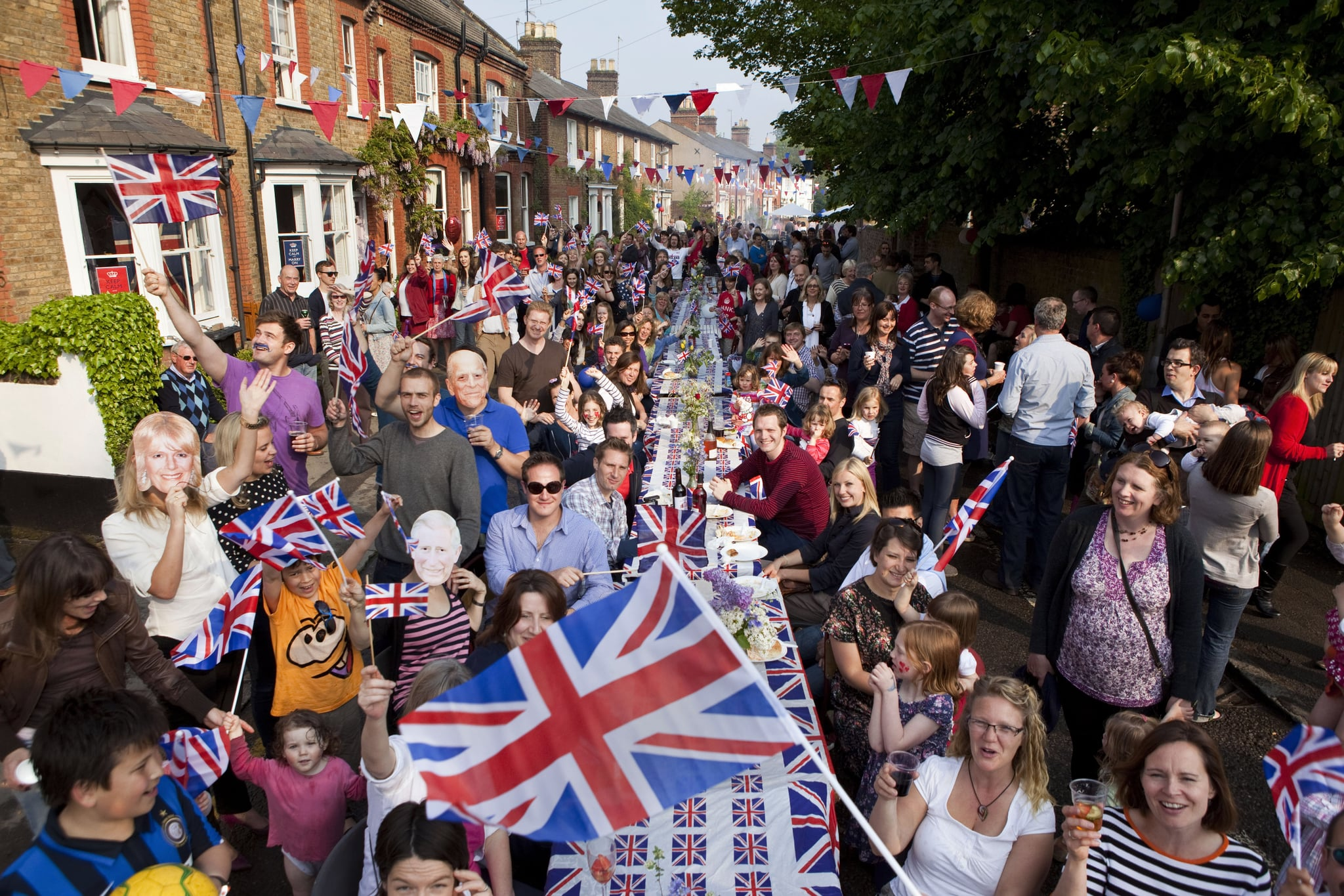 BERKHAMSTED, UNITED KINGDOM - APRIL 29:  Residents at a Royal Wedding Street Party celebrate the marriage of Prince William and Catherine Middleton, in Chapel Street in Berkhamsted on April 29, 2011 in Berkhamsted, England. The marriage of Prince William, the second in line to the British throne, to Catherine Middleton is being held in London today. The Archbishop of Canterbury conducted the service which was attended by 1900 guests, including foreign Royal family members and heads of state. Thousands of well-wishers from around the world have also flocked to London to witness the spectacle and pageantry of the Royal Wedding and street parties are being held throughout the UK. (Photo by David Levenson/Getty Images)