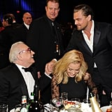 Leonardo DiCaprio shook hands with Martin Scorsese while Margot Robbie laughed.