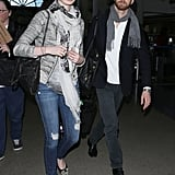 Upon landing at LAX airport, Anne Hathaway showed off a casual-cum-cool look: Vanessa Bruno sweater, ripped Genetic jeans, and this Stella McCartney Falabella bag in ruthenium ($1,195).