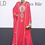 Giovanna Battaglia embraced an exotic aesthetic in a hot pink embellished gown and seriously shiny gold accessories.
