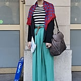 A flowy turquoise skirt gave a striped tee and a dotted scarf a fresh pop of color.