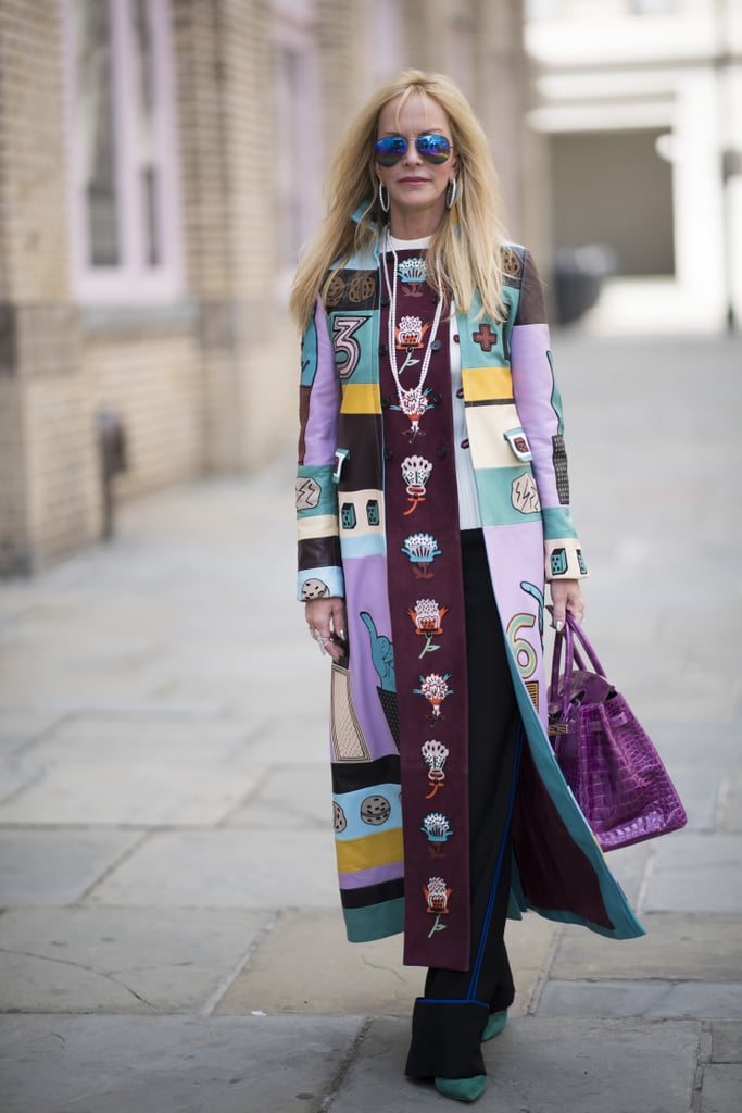 If you don't want to wear a full-on purple look, mix it in with other colors. This street style star pulls it off perfectly with her Valentino trench coat.