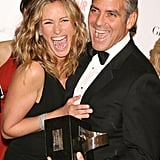 George Clooney and Julia Roberts goofed off at an LA event in October 2006.