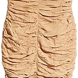 Do Burberry on a budget with this high waisted skirt (£24.99).