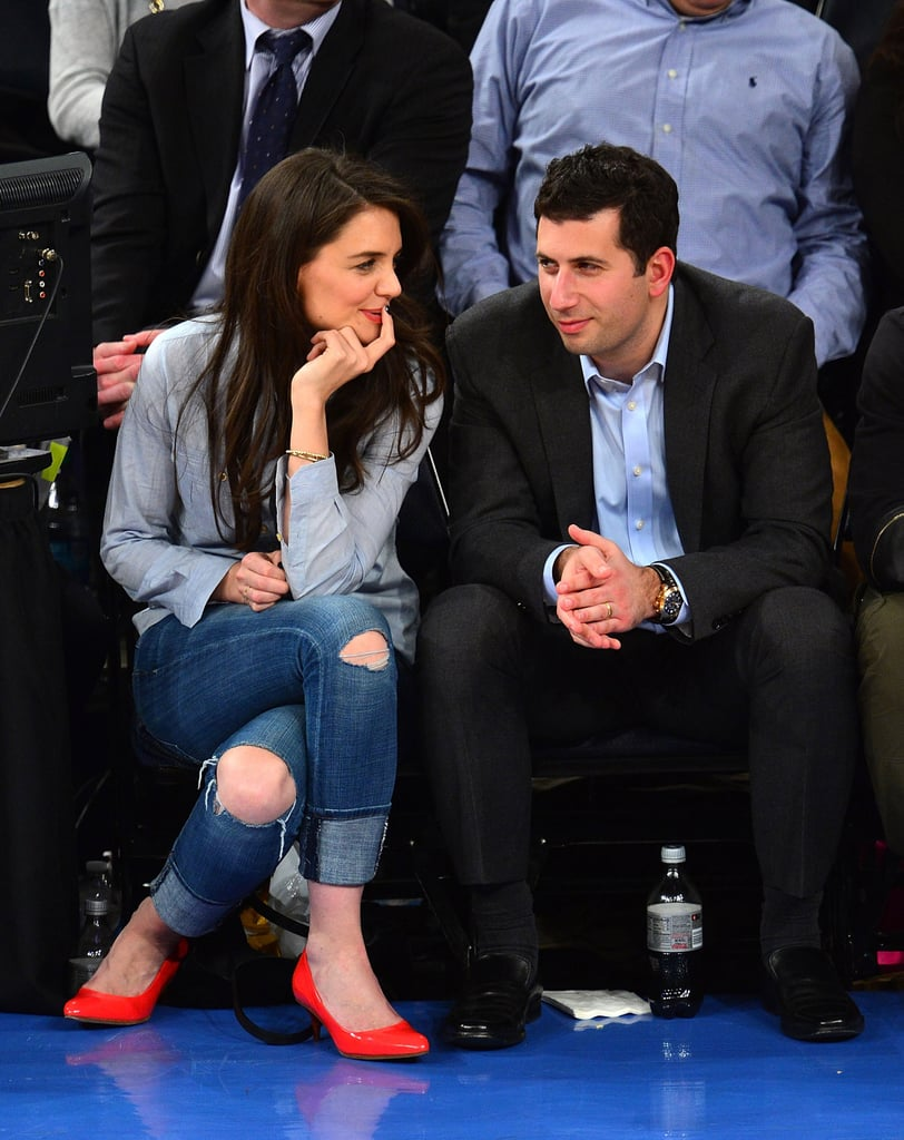 Katie Holmes chatted with her agent during the game.