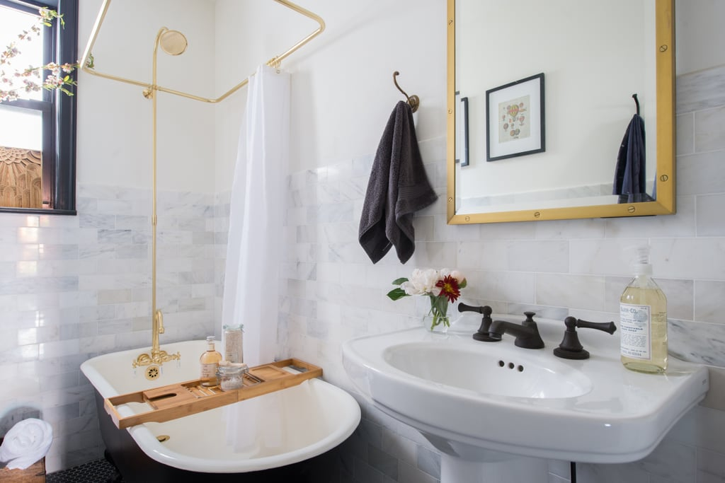 Black-and-White Bathroom With Brass Shower