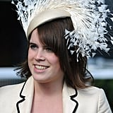 In June 2008, Eugenie's cream hat was covered with feathers.