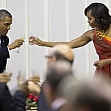 President Obama and First Lady Michelle clinked their glasses together while visiting Pretoria, South Africa, in June 2013.