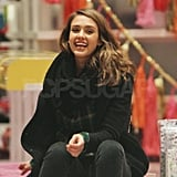 Jessica Alba joked with a friend while shopping in the Big Apple.