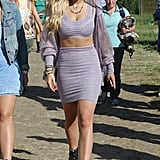 Rita Ora went for an all-lilac look (save for black boots), showing off a toned stomach in a tight skirt, bra top, and hoodie.