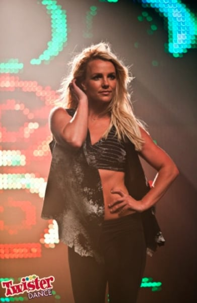 """Britney Spears showed her abs while at a shoot for a new Twister Dance game. She looked sexy in a $20,000 sports bra featuring diamond details and a gold zipper by BodyRock. Britney and Twister shared a handful of behind-the-scenes images from their day with the camera. Britney was happy with the results and posted on Path, """"Couldn't be happier with the Twister Dance video shoot! It's gonna be so hot."""" Britney's moving forward with her Twister deal, and may actually be close to inking another big money gig. Britney Spears's X Factor negotiations are back on and it's being reported that she's close to signing on to the show for a $15 million payday. She's had help securing the contract from her fiancé Jason Trawick. As she and Jason get closer to their wedding day, he's being lined up to become her legal coconservator alongside her dad Jamie Spears."""