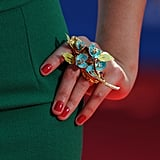 Lo Bosworth's floral ring, which matched her green sheath dress, gives oversized a whole new meaning!