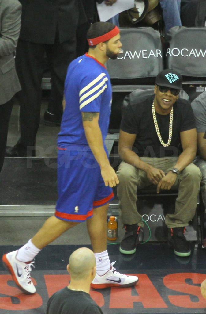 Jay-Z watching a Nets game.