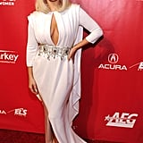 Lady Gaga struck a pose while walking the red carpet at the 2014 MusiCares Person of the Year event honoring Carole King.