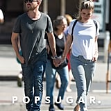 Aaron Paul Showers His Wife With Kisses During Their NYC Outing