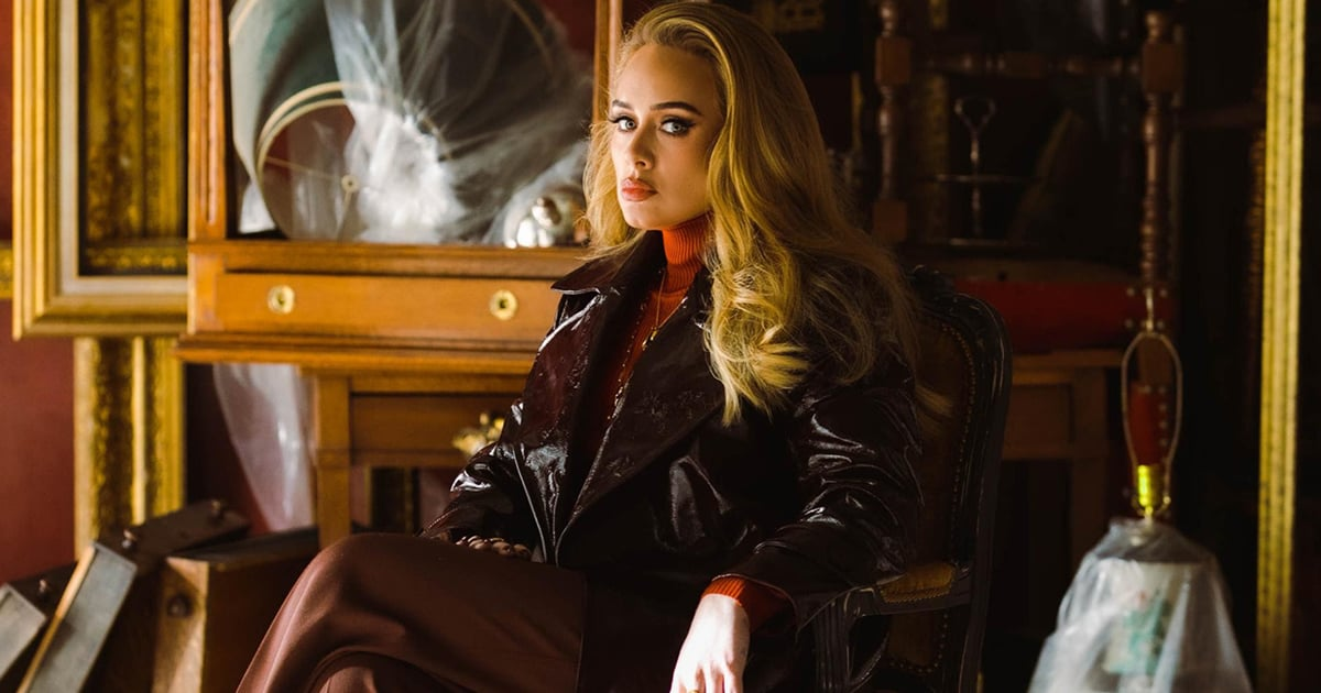 """Adele's Oxblood Leather Trench Coat Was the True Star of the """"Easy On Me"""" Music Video.jpg"""