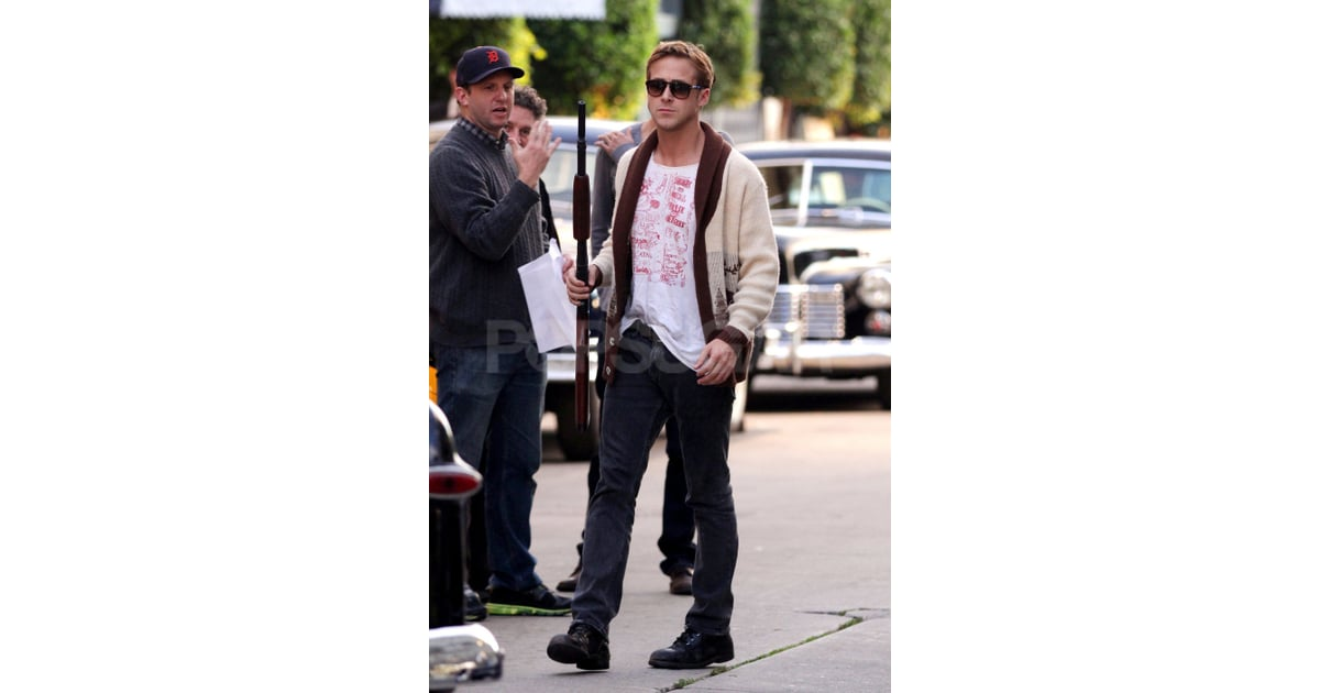 514032f72f907 Ryan Gosling carried a big gun to rehearse a scene for Gangster Squad.
