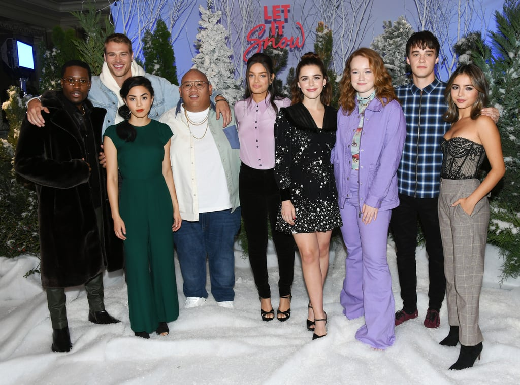 Just one day after Halloween, the cast of Netflix's Let It Snow gathered for a snowy, celebratory photocall in LA. Kiernan Shipka posed for playful snaps with Mitchell Hope and Matthew Noszka, while Liv Hewson — a vision in purple — stayed close to Anna Akana, Odeya Rush, and Jacob Batalon. Shameik Moore and Isabela Merced also posed with the group while surrounded by pine trees and fake snow.  The teen ensemble rom-com is based on the YA book  Let It Snow: Three Holiday Romances, and follows a group of teens as they weather a snowstorm in their small town on Christmas Eve. It hits Netflix on Nov. 8, but if you'd rather just skip to the book spoilers, just head here.