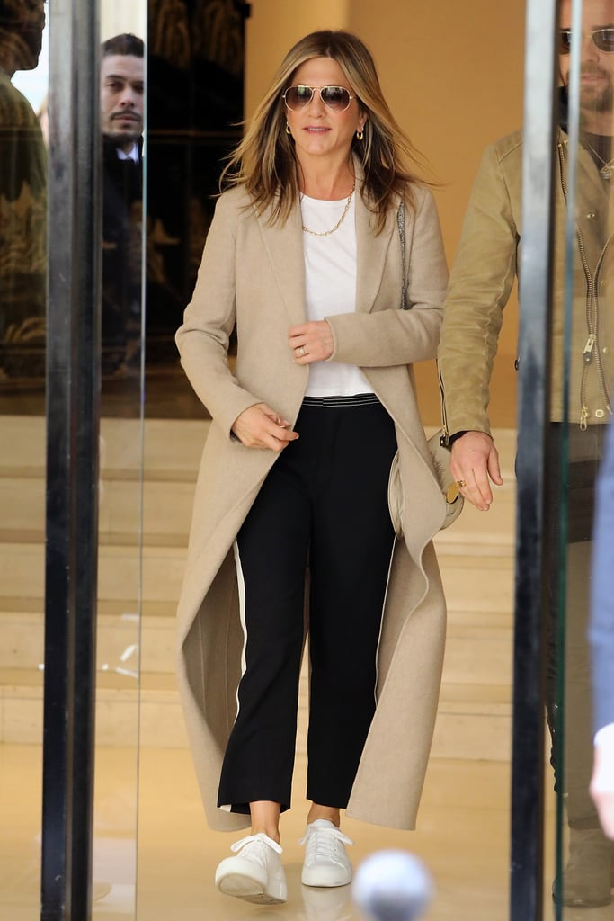 Jennifer Aniston Styled a Plain White T-Shirt With Side-Striped Pants and White Sneakers