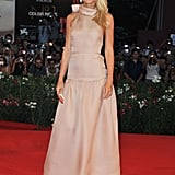 Gwyneth Paltrow glowed in a blush pink organza gown by Prada paired with matching peep-toe pumps and dazzling Bvlgari earrings at the Contagion premiere.