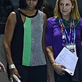 First Lady Michelle Obama watched some of the swimming events on day two in an asymmetrical cutout top by BCBG ($138) and sleek black trousers. Unlike many of her more patriotic-minded outfits, she opted for a casual-meets-contemporary look here.