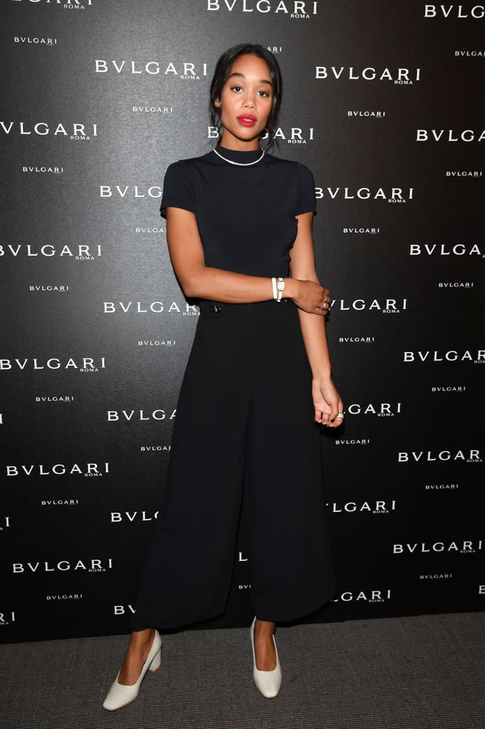 Wearing a black turtleneck tucked into a pair of chic culottes. She styled the monochromatic look with a pair of checkered white heels.
