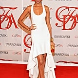 Joan Smalls wore a sexy, minimalistic white gown from her date for the night, Michael Kors.