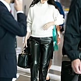 Fall staple: An ivory ribbed Louis Vuitton sweater with a zipper turtleneck. Selena wore it with: Louis Vuitton leather trousers and pumps, Céline sunglasses, and a Le Snob duffel bag in Paris in September 2015.
