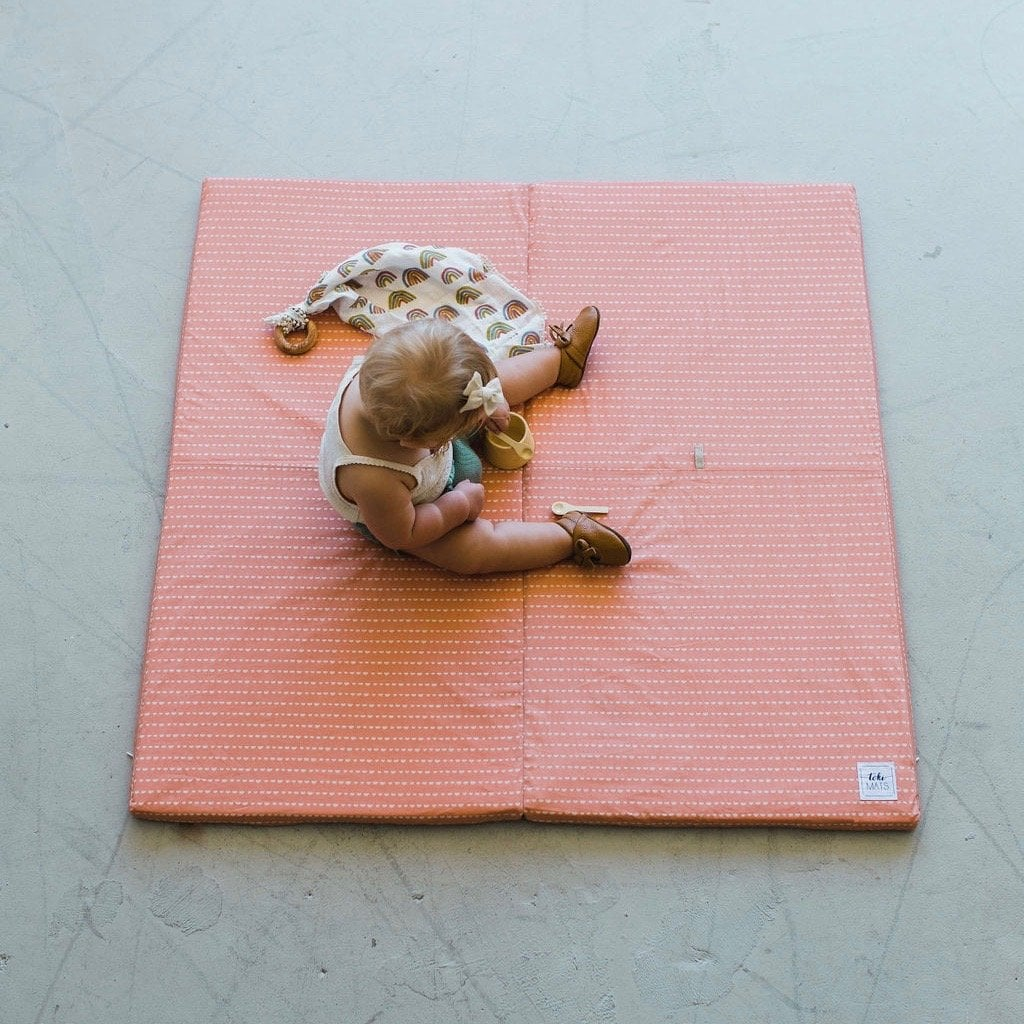 Coral crescent padded play mat