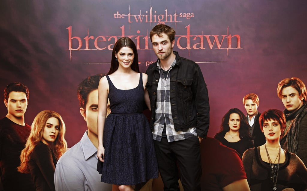 """Robert Pattinson and a Peter Som-wearing Ashley Greene took their Twilight tour to Brussels today. They kicked off press for Breaking Dawn Part I in Paris on Sunday and will travel to Sweden for another premiere on Friday. Rob and Ashley's time in France wasn't all about work, since they were spotted at dinner with friends after their red carpet appearances. Ashley also made time to sightsee and checked out the Palace of Versailles, later tweeting that her """"mind was blown. It was so incredibly beautiful. Lots of history. I highly recommend it to everyone."""" Rob and Ashley's costar Kristen Stewart hasn't joined them overseas, since she's busy filming Snow White and the Huntsman in England. Kristen should be able to join the cast next month when she, Taylor Lautner, and Rob are honored with a Hollywood handprint ceremony ahead of the film's big LA premiere on Nov. 11."""