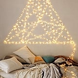 Create beautiful holiday wall art with mounted lights.