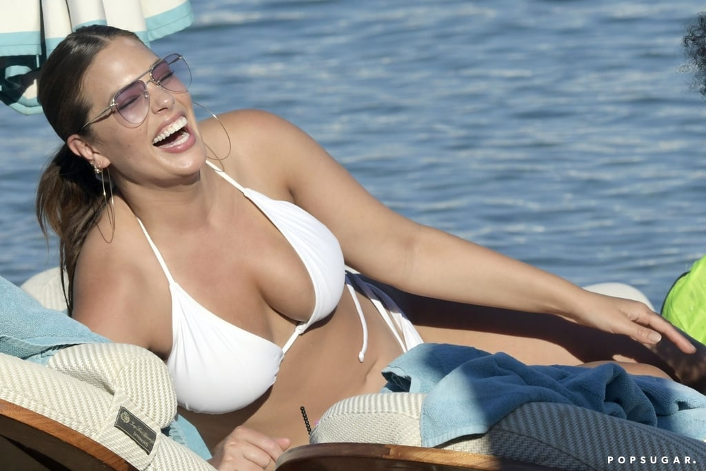 """Ashley Graham is living it up this Summer! Following her PDA-filled getaway with husband Justin Ervin in Italy, the 30-year-old curve model returned to the beach over the weekend, only this time in Greece. Ashley rocked a sexy white string bikini, and shared a few laughs with friends while soaking up the sun in Mykonos. Ashley's also been posting tons of fun photos from her trips on Instagram, and on Sunday, she posted a silly snap of herself by the pool, writing, """"Another day, another bikini 👙."""" BRB, booking a trip to Greece.       Related:                                                                                                           74 Snaps That Prove Ashley Graham Is Ridiculously Sexy"""