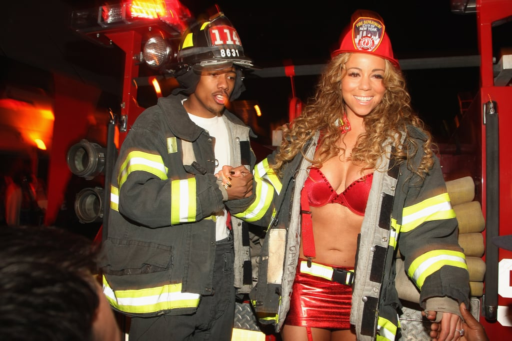 Nick Cannon and Mariah Carey put out the fire in October 2008 at their NYC Halloween party.