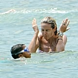Heidi Klum plays in the water.
