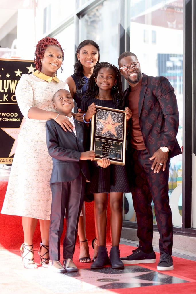 Kevin Hart had the support of his beautiful, blended family at his Hollywood Walk of Fame ceremony in LA on Monday afternoon. The Jumanji actor, who was honored with the 2,591st star on the Walk of Fame in the category of live performance, posed for photos with his wife Eniko Parrish, his ex-wife Torrei Hart, and their two kids, daughter Heaven and son Hendrix Hart. Also in attendance was Halle Berry, who appears in his upcoming What Now? documentary.   In addition to promoting his KevMoji app, Kevin has also been busy filming his latest movie, Jumanji, with pal Dwayne Johnson. Not only has it yielded a surge of hilarious moments between the two stars, but Dwayne and Kevin have also developed quite the bromance. Over the weekend, Dwayne shared an Instagram video of him and Kevin shooting a scene that called for Kevin to be harnessed to his back, and the results were pure gold.       Related:                                                                22 Times Kevin Hart Straight-Up Spoke to Your Soul                                                                   The Jumanji Sequel Plans to Honor Robin Williams With a Touching Tribute