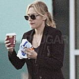 Kate Winslet juggled coffee and a bite.