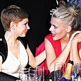 Michelle Williams and Busy Philipps talk it out at their table.